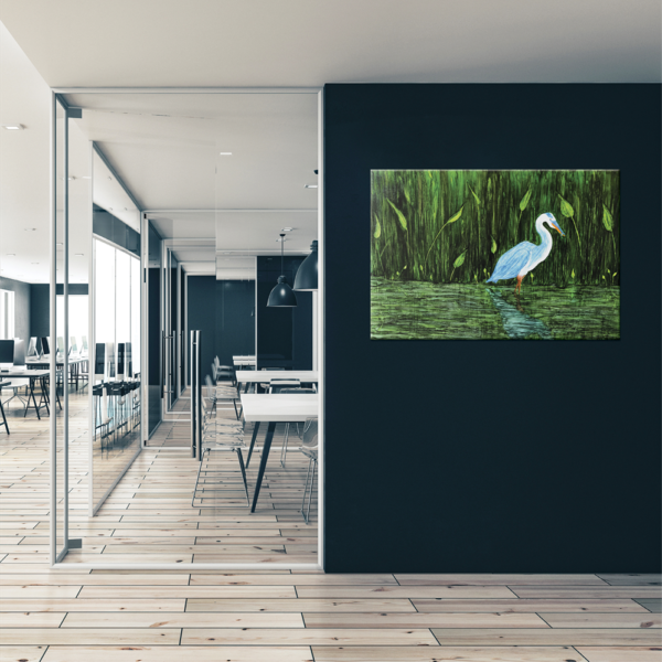 A bird painting on a black wall in an office environment
