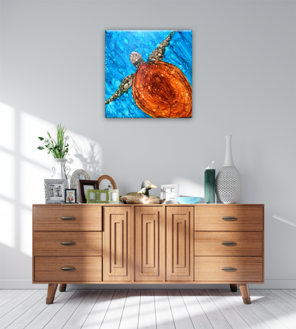Turtle painting on a wall above a side table