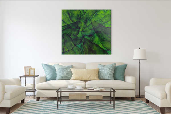 Green painting above a light colored sofa in a living room
