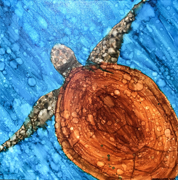 An alcohol ink painting of sea turtle looking down onto turtle. Blue background and streaks and lighter bubble shapes throughout the painting. Turtle swimming from lower right to upper left with it's arms reached out and going off of the canvas.